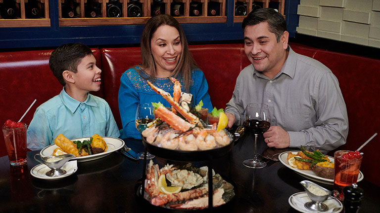 family of three enjoying fish fry dinners and seafood